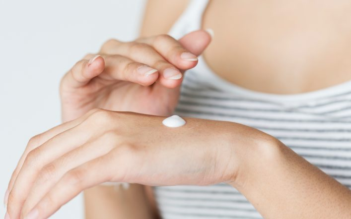 White lotion in a lady's hand